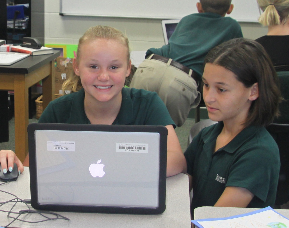 middle school using laptop